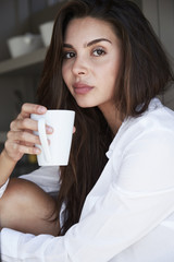 Portrait of beautiful woman with coffee cup