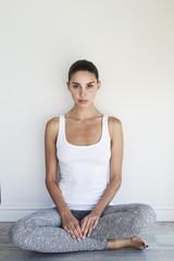 Beautiful woman sitting on floor in studio