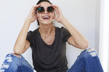 Laughing babe in shades, portrait