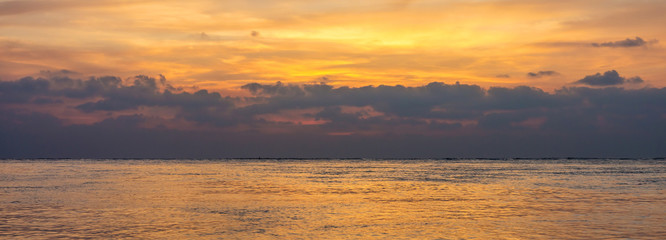 Seascape photograph of Andaman sea with cloudy sky in the morning or evening. This panorama view at Phang Nga, Thailand, Southeast Asia.