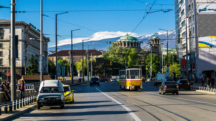 "The church ""Sveta Nedelya"" cathedral of the Sofia bishopric. Traffic Boulevard Knyaginya Mariya Luiza, in the background the Vitosha Mountain. Bulgaria"