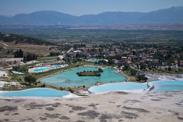 wonderful view on beautiful limestone hot natural turquoise springs in cotton castle, pamukkale, turkey
