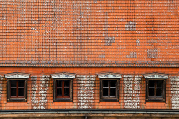 Retro red tile roof of old house in europe