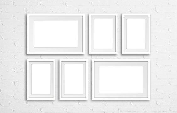 Six photo frames set mock up isolated on white bricks wall background