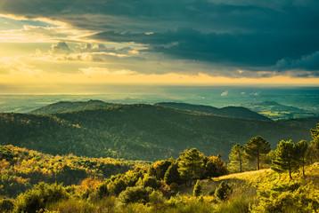 Maremma sunset panorama. Countryside, hills and sea on horizon. Rosignano Vada, Tuscany, Italy.