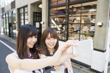 Young women are enjoying shopping