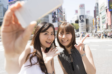 Women are shooting in smart phone in Shibuya, Tokyo