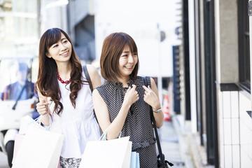 Two women are enjoying shopping on holidays