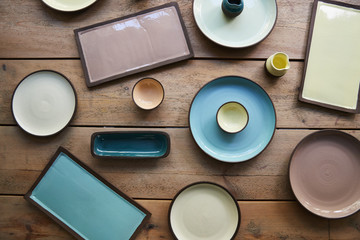 Handmade earthenware on a wooden table, overhead shot