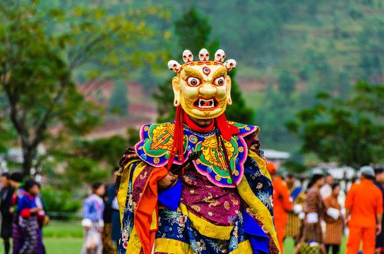 Bhutan, masked dancer at a traditional monastery festival the Wangdue Phodrang Tsechu A monk in a colorful dress with mask during the tsechu (dance festival) in Wangdue, Bhutan.