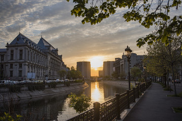 Bucharest city center at sunset - Justic Palace and Dimbovita river.