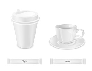 White disposable packaging for sugar and coffee. Glass cup with saucer and paper coffee cup