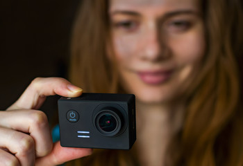 Smiling woman with action camera