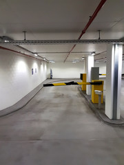 parking barrier gate in garage lot for security and pay the entrance or exit with car or motorbike