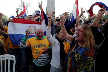 People celebrate the rejection of a proposed amendment to allow presidential second terms, in front of the Paraguayan Congress, in Asuncion, Paraguay