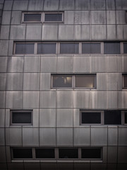 steel office building with weathered panels steel cladding and windows