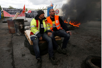 Whirlpool union representatives attend a demonstration with employees outside the company plant in Amiens