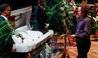 Bill Flowers salutes Chuck Berry as he pays his respects to the late rock 'n' roll visionary during his funeral at The Pageant club in St. Louis
