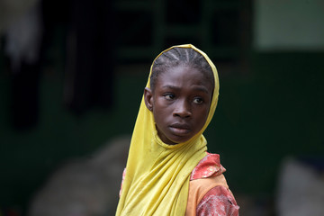A girl walks through a shelter for displaced people in Bangui, Central African Republic