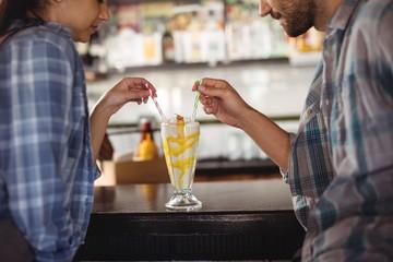 Couple having milkshake at counter