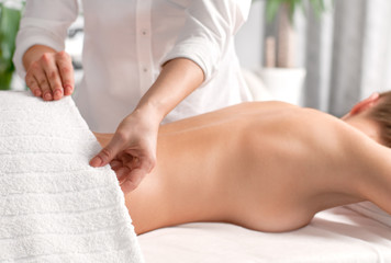Woman having massage of body in the spa salon.