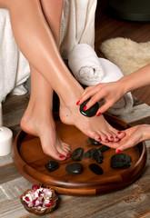 Wall Murals Pedicure Female feet in spa salon, pedicure procedure