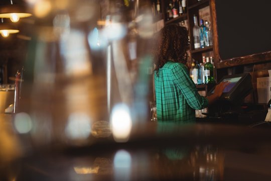 Female bar tender using electronic machine