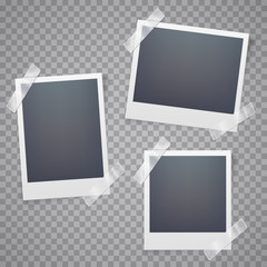 Collection of blank photo frames with adhesive tape.