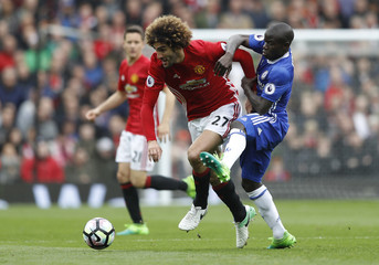 Manchester United's Marouane Fellaini in action with Chelsea's N'Golo Kante