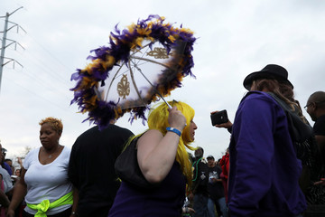 A woman has her photo taken during the 24th Annual Zulu Lundi Gras Festival during Mardi Gras in New Orleans, Louisiana