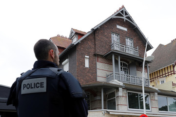 Police stand guard in front of head of the political movement En Marche !, or Onwards !, and candidate for the 2017 French presidential election Emmanuel Macron's house in Le Touquet, France