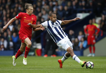 West Bromwich Albion's Salomon Rondon in action with Liverpool's Lucas Leiva