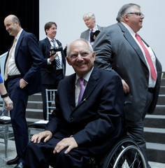 German Finance Minister Wolfgang Schaeuble smiles after G-20 family photo during the IMF/World Bank spring meetings in Washington