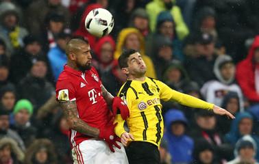 Bayern Munich's Arturo Vidal in action with Borussia Dortmund's Sokratis Papastathopoulos