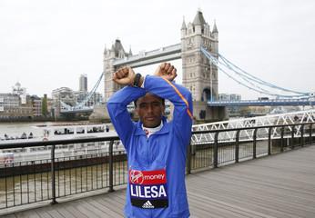Feyisa Lilesa of Ethiopia poses for a photo ahead of the 2017 Virgin Money London Marathon