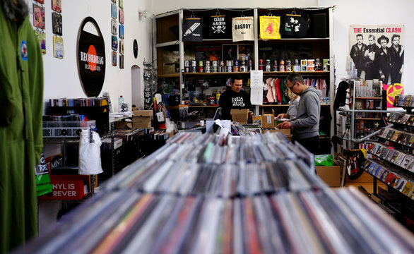 Employees check vinyl albums in the Recordbag shop ahead of the International Record Store day in Vienna