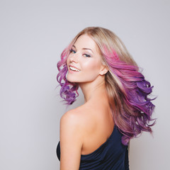 Colored hairs. Portrait of smiling women with flying . Ombre. Gradient