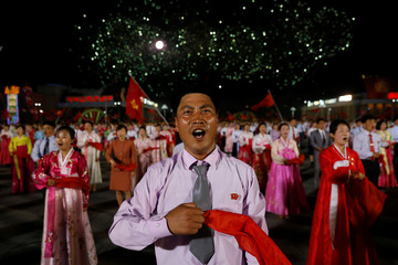 People take part in a mass dance event marking the 105th birth anniversary of the country's founding father, Kim Il Sung, in Pyongyang