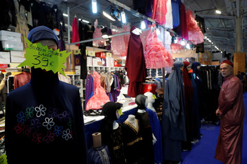 A stand displays women's clothes, including burkini's, during the 34th annual meeting of French Muslims, the cultural and festive event organized by the Union of Islamic Organizations of France (UOIF) at Le Bourget