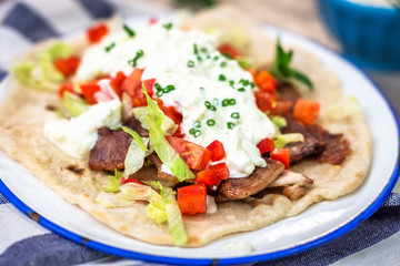 Gyros with vegetable, meat and tzatziki sauce
