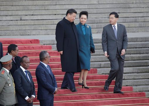 China's President Xi Jinping and his wife Peng Liyuan arrive for a welcoming ceremony in Beijing