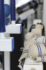 Elastic sports bandages on dumbbells