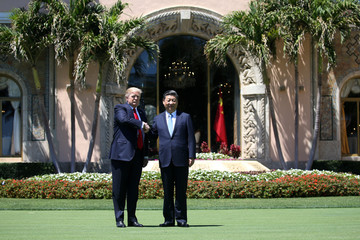 U.S. President Donald Trump and China's President Xi Jinping shake hands in front of the Mar-a-Lago estate after a bilateral meeting in Palm Beach
