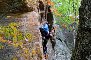 Rock climber ascending a sport route in Red River Gorge, Kentucky, on some wonderful sandstone.