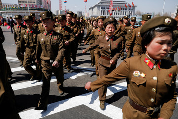 North Korean soldiers march as they visit the newly constructed residential complex after its opening ceremony in Ryomyong street in Pyongyang