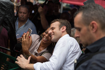 Emmanuel Macron, head of the political movement En Marche and 2017 presidential candidate of the French centre-right poses for a selfie as he visits the Chaudron market in Saint-Denis as he campaigns on the French Indian Ocean island of the Reunion