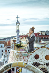 tourist woman at Guell Park in Barcelona, Spain having excursion
