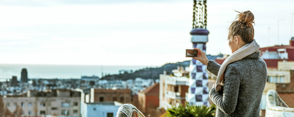 tourist woman in Barcelona taking photo with digital camera
