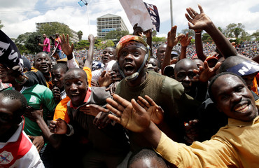 Supporters of Kenyan opposition National Super Alliance (NASA) coalition cheer at a rally endorsing Raila Odinga as the presidential candidate for the 2017 general elections at the Uhuru Park grounds, in Nairobi