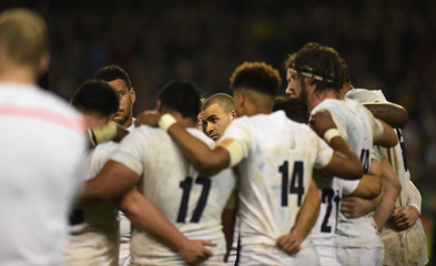 England players in a huddle at the end of the match